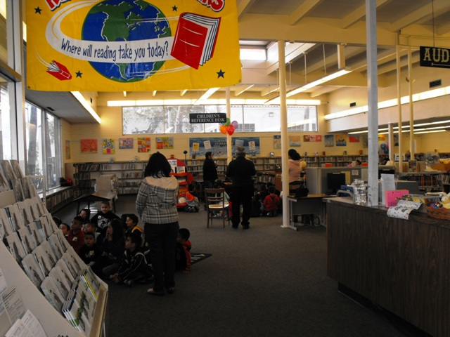 Children listening to a book reading at the Library